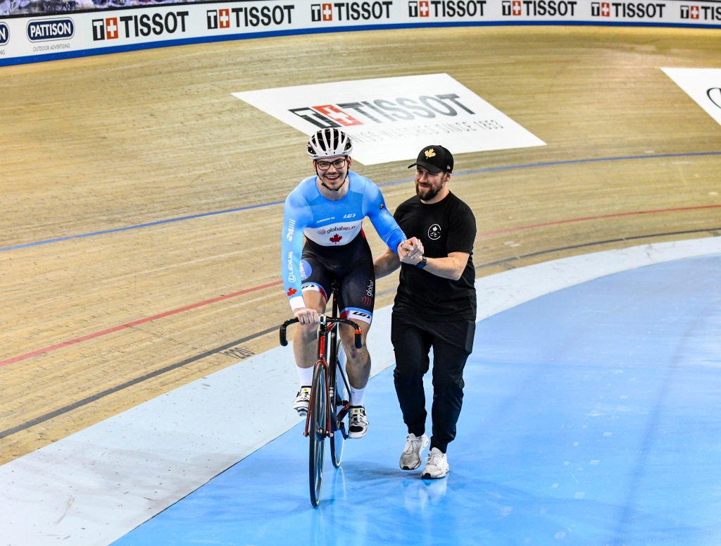 Reunited with coach Franck Durivaux Photo Credit: Canadian Cyclist